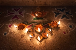 9 Lamps on Rangoli and Kolam Powder