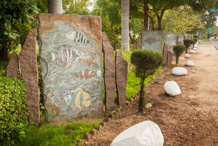 Paintings on stone slabs next to the highway at the entrance of Puducherry